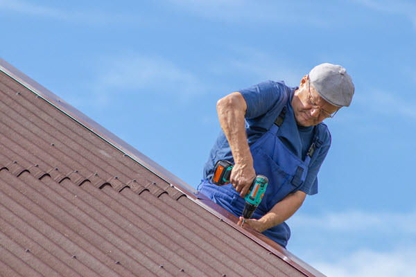 Worker located on a roof making a repair